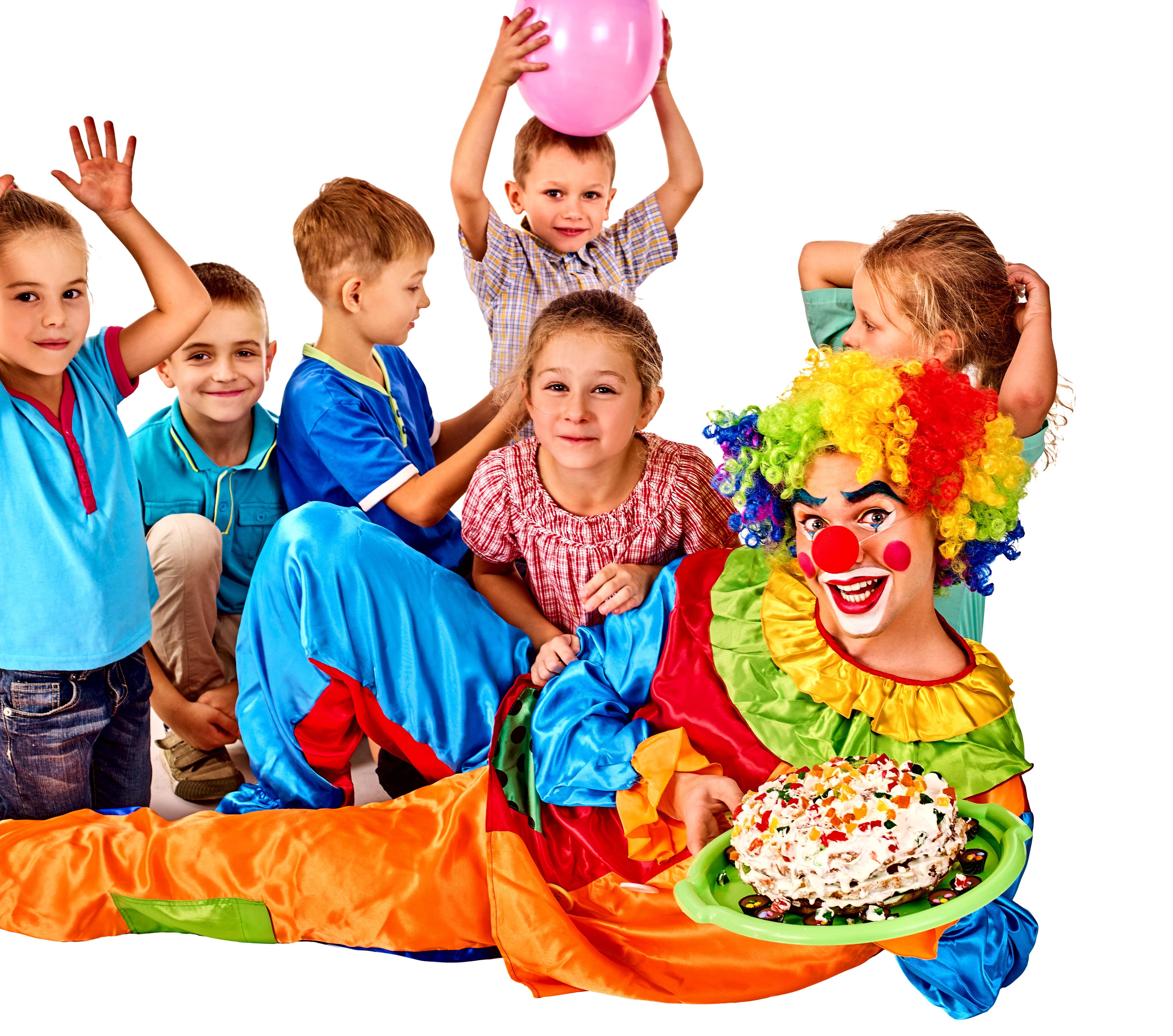 clown with children and birthday cake