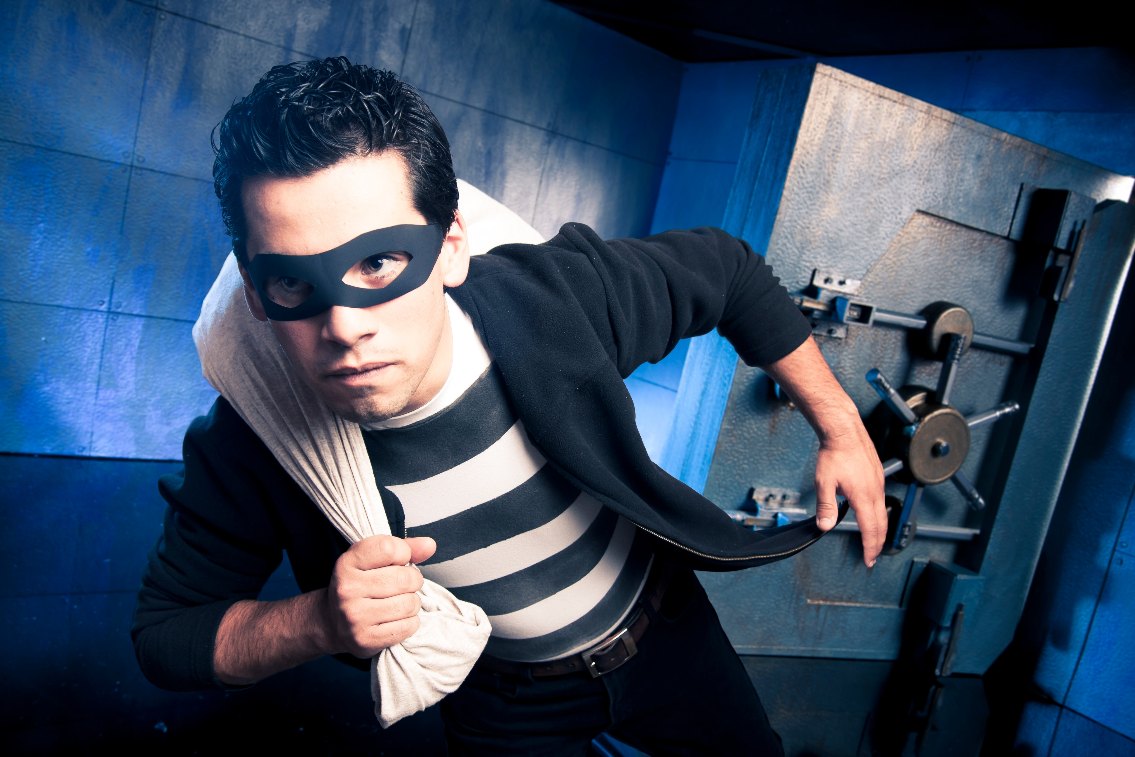 robber leaving bank safe.jpg