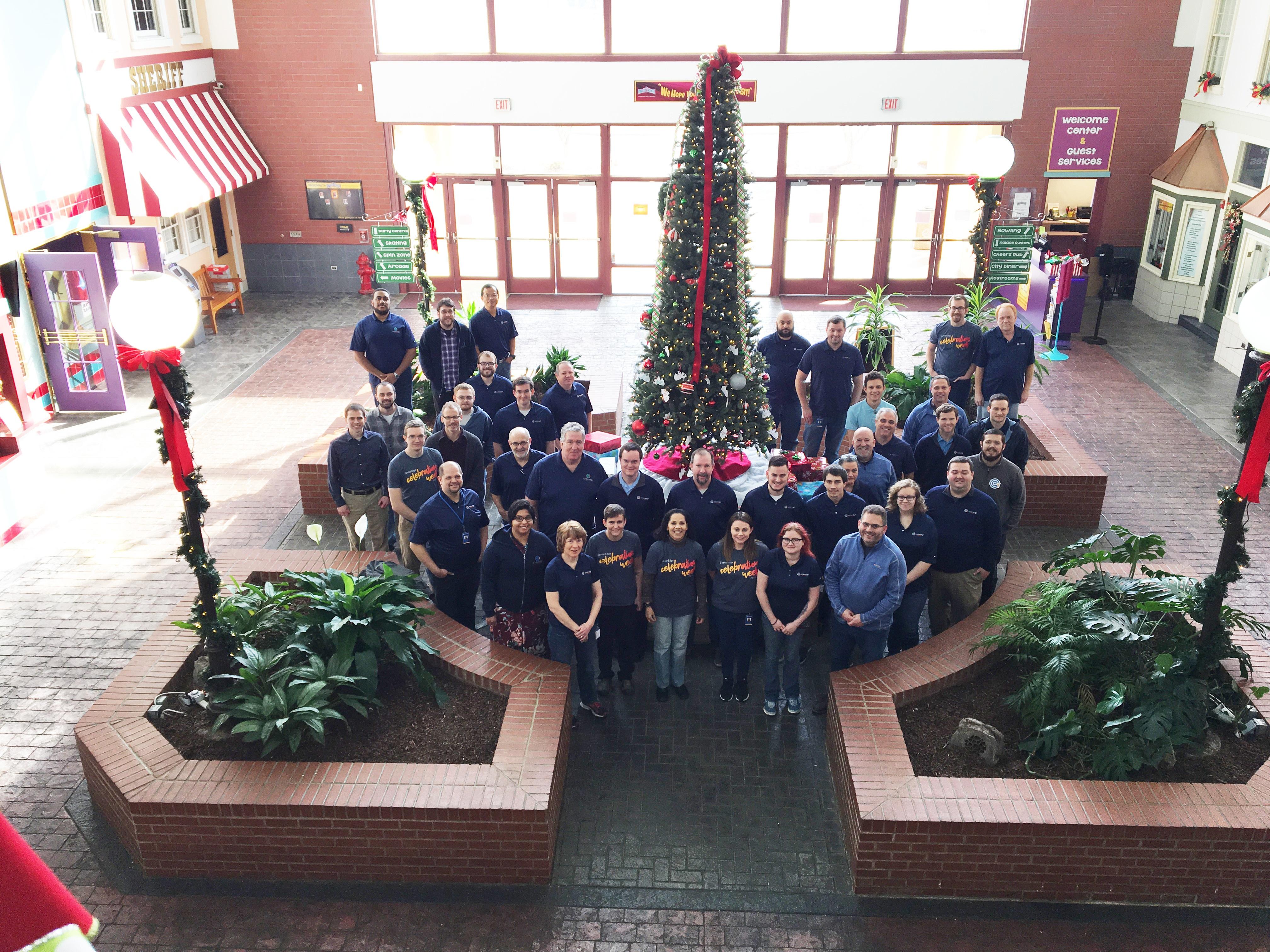 CenterEdge team standing around Christmas tree