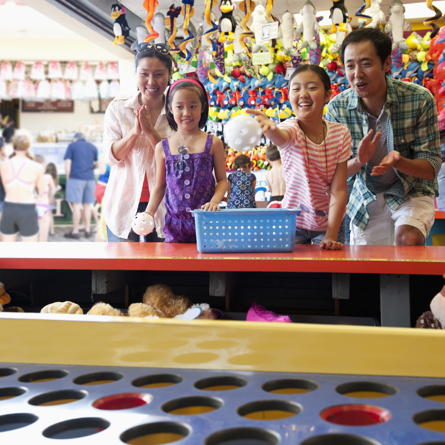 family playing ball toss fair game