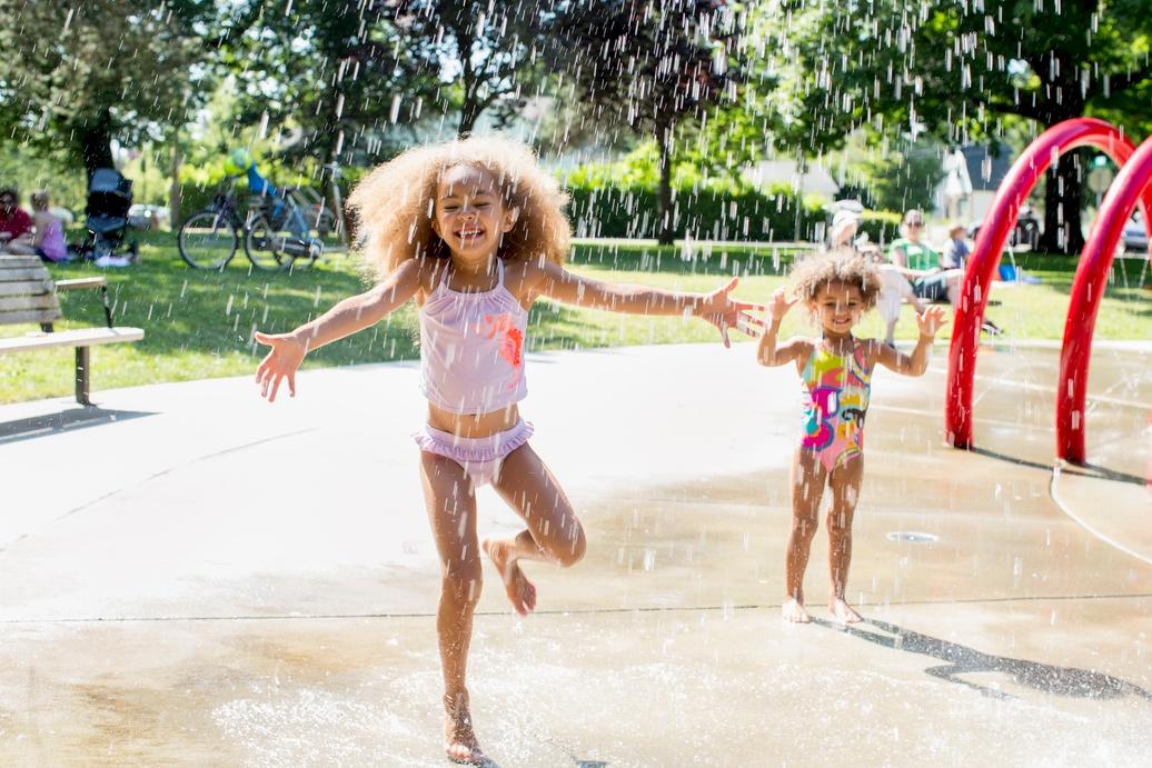 girl running through fountain.jpg