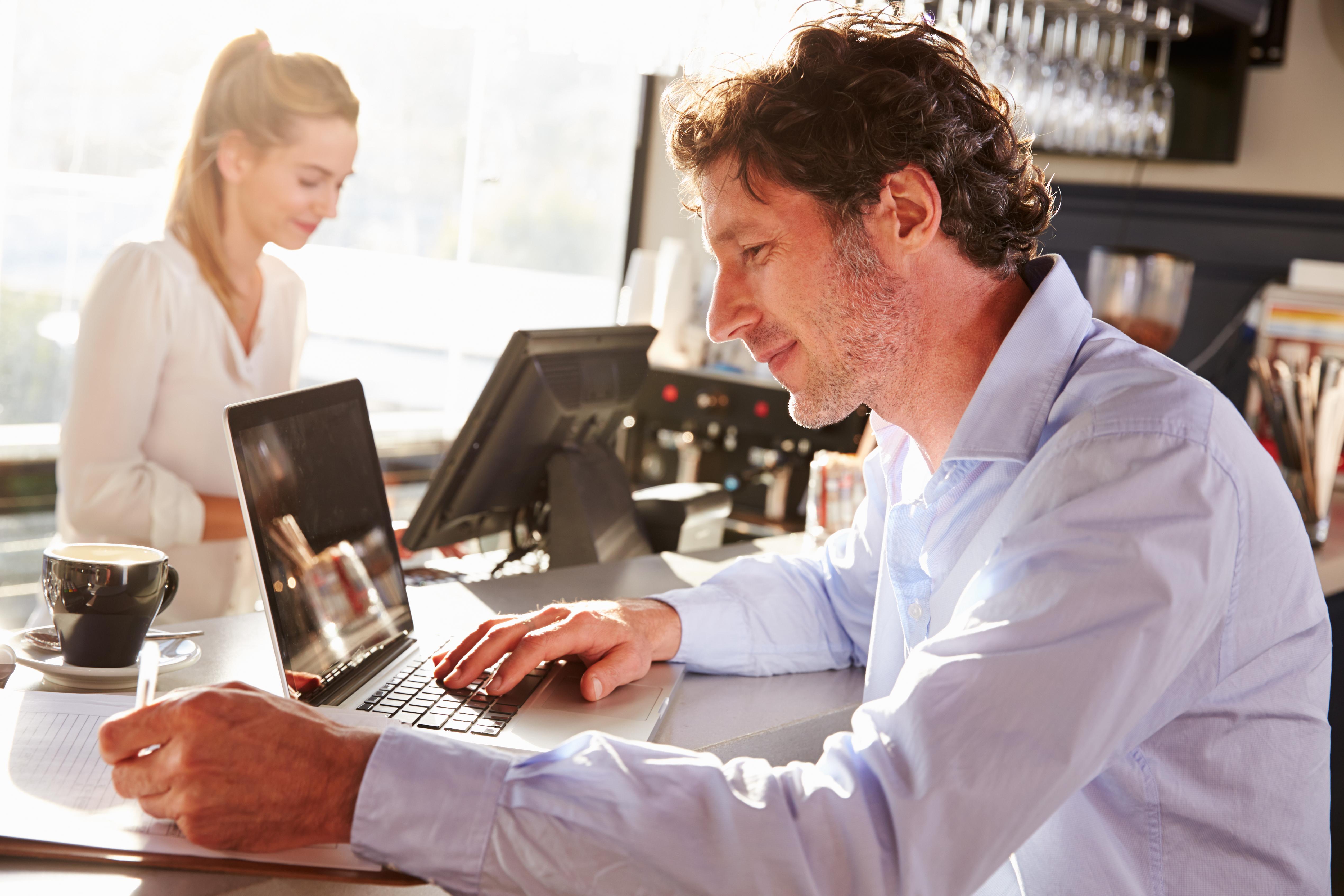 man sitting at computer working