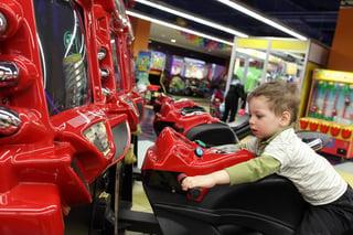 boy playing arcade game.jpg